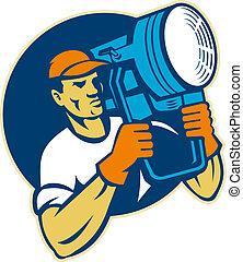 film lighting crew holding a spotlight - illustration of a...
