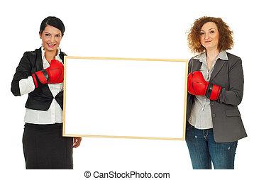 Women with boxing gloves and banner - Two business women...
