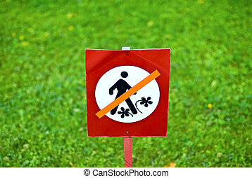 Keep off grass - Keep off grass flowers sign over green...