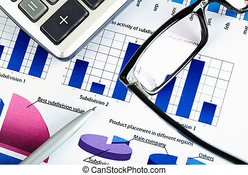 Business objects - Close-up of eyeglasses and pen over...