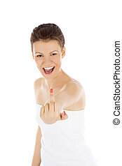 Young woman showing middle finger over white