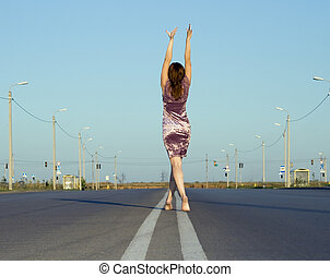 girl in  dress walk barefoot on empty road