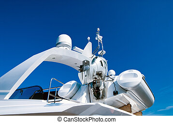 Modern yacht - Top of modern yacht with motor-boat over blue...