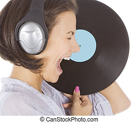 Profile of emotional brunette in headphones with vinyl...