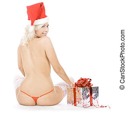 Wonderful female in santa hat and white stockings near...