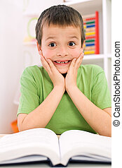 Little boy forgot reading - back to school concept - Little...