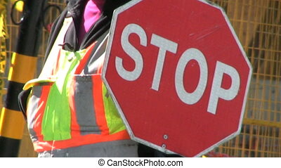 Stop Sign Lady At Construction Site - A female construction...