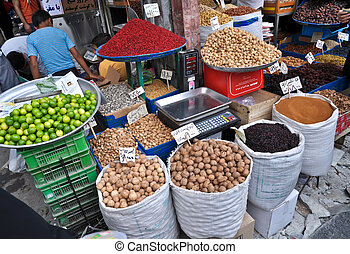 spices and nuts on the scales and dishes in an old bazaar in...