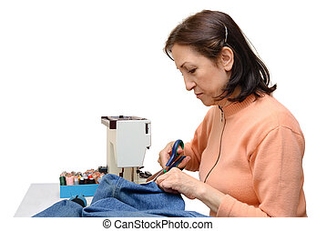 Seamstress during work, isolated - Isolated studio shot of...