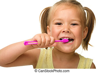 Little girl is cleaning teeth using toothbrush - Cute little...
