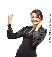 Portrait of a happy young businesswoman talking on cellphone...