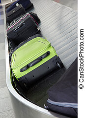 luggage airport - suitcases on the baggage conveyor band on...