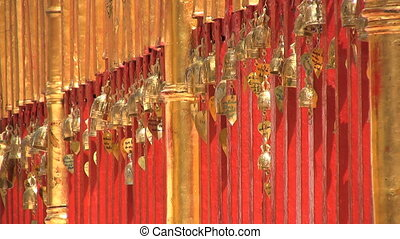 Small Gold Temple Bells - A row of small gold temple bells...