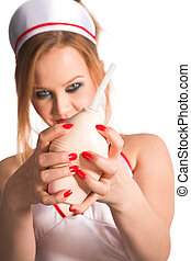 sexual nurse - young beauty sexual nurse on white background