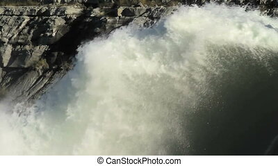 Spillway water spout - Large water spout at the bottom of a...
