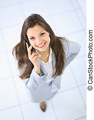 Portrait of a beautiful business woman talking on her mobile phone