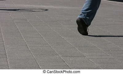 Sidewalk Circle Action - Cyr Wheel - A man using a Cyr Wheel...