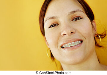 young college student smiling at camera - portrait of young...