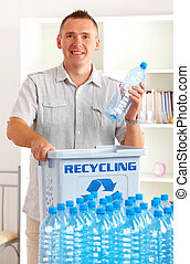 Recycling Man With Bottles - Happy man holding plastic...