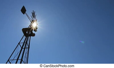 Farm windmill with sun