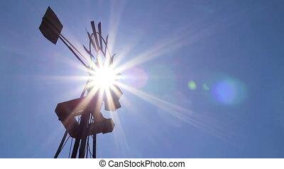 Farm windmill with sun