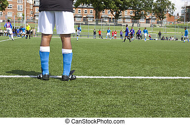 Footballer's legs - Rear view of substitute soccer player...