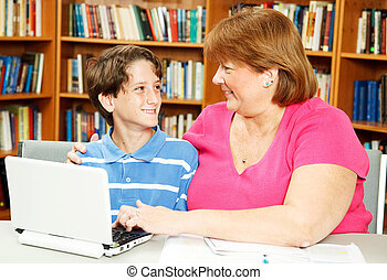 Mom and Son in Library - Mother or teacher, helping a little...