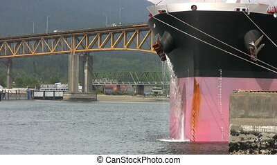 Ship Purging Water - A large container ship purges water...