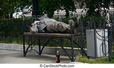 man sleeping on a bench