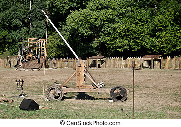 Medieval catapult - Side view of a medieval wooden catapult.