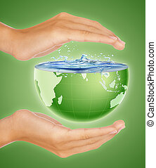 Saving the earth concept - Hands around half earth globe....