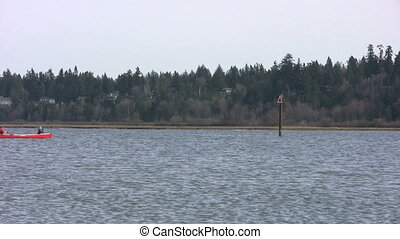 Red Canoe On The Ocean - A pair of outdoor enthusiasts...