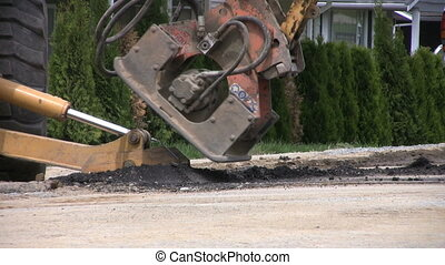 Road Compacter Machine Close Up - A close up shot of a road...