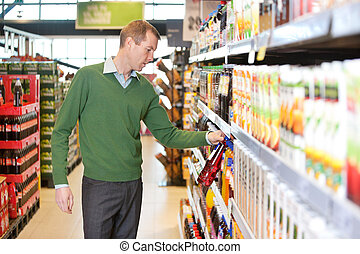 Man buying juice in the market - Man buying juice in the...