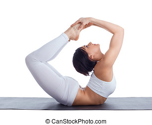 woman in back bends yoga - bow pose isolated - Beauty girl...