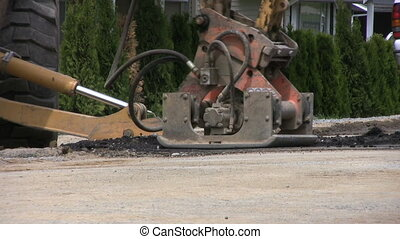 Road Compacter Machine - A road compactor machine working on...