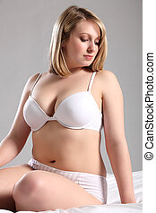 Beautiful Voluptuous woman in white lingerie