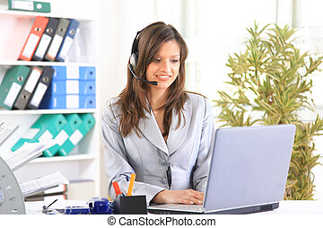 Portrait of a beautiful business woman working at her desk...