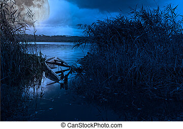 Full moon boat - Photo composition with sunken boat in a...