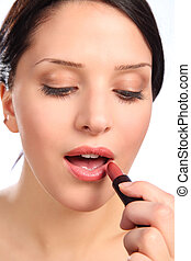Beautiful young woman with make up lipstick