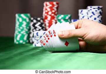 Place a poker player chips and card