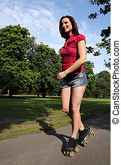 Summer fun sexy long legged woman roller skating - Fit...