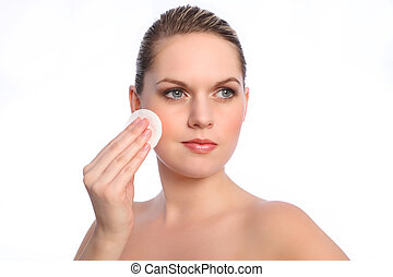 Girl using cosmetics cotton cleansing pad on face -...