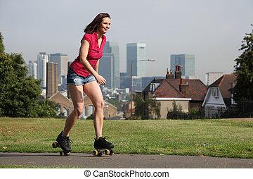 Beautiful woman summer fun roller skating London