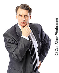 Portrait of a successful mature business man standing with folded hand on white background