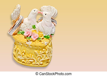 wedding invitation with two kissing pigeons on the ring box...