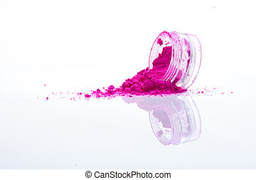 spilled pink makeup powder from jar