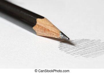 Graphite pencil - Close up of black graphite pencil on the...