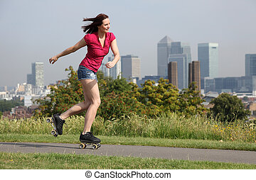 Sexy woman roller skating activity in London UK - Summer fun...