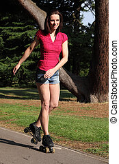 Tall long legged girl has fun roller skating - Leisure...